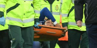 Gomes carried off after serious leg injury