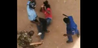 The video shows Kenya police officers beating a student