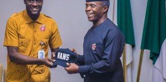 Global President of NANS, Comr. Danielson Bamidele Akpan presenting Vice President Yemi Osinbajo with a cap