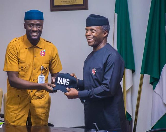 Global President of NANS, Comr. Danielson Bamidele Akpan presenting Vice President Yemi Osinbajo with a cap