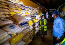 Lagos State Governor, Mr. Babajide Sanwo-Olu (right), and his Special Adviser on Agriculture, Ms. Abisola Olusanya (left) during an inspection of the COVID-19 Emergency Food Response by the Lagos Government, at the Ministry of Agriculture and Cooperatives premises in Agege, on Friday, March 27, 2020