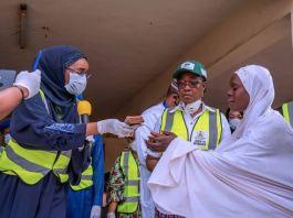Minister of Humanitarian Affairs, Disaster Management & Social Development, Sadiya Umar Farouq giving money to poor Nigerians
