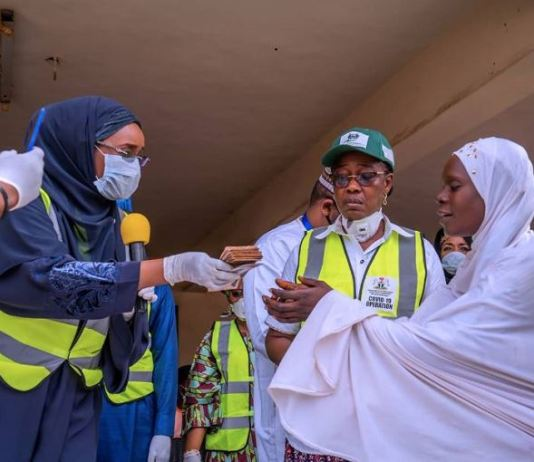 Minister of Humanitarian Affairs, Disaster Management & Social Development, Sadiya Umar Farouq giving money to poor Nigerians