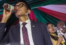President Andry Rajoelina of Madagascar drink the coronavirus cure during a presentation