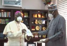 Nigerian Prelate of Catholic Church in Nigeria Archbishop Ignatius Kaigama presents the hospitals to Boss Mustapha