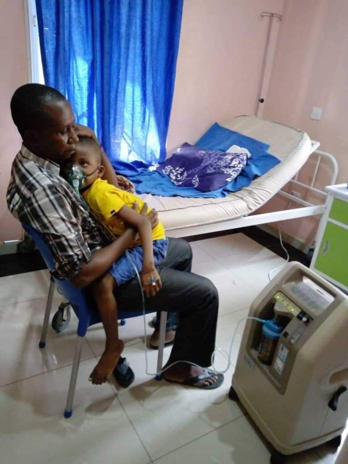 Prosper Chiebuka Chinonso in his father's arms