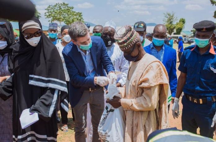 Nigeria Country Director, World Food Programme, Paul Howe and Honourable Minister of Humanitarian Affairs, Disaster Management and Social Development, Sadiya Umar Farouq at the flag off of the modified Home Grown School Feeding Programme in Abuja