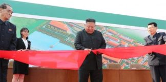 State media issued this picture said to show Kim Jong-un opening a fertiliser plant on Friday