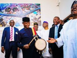 Vice President Yemi Osinbajo plays the drum to the amusement of late Governor Abiola Ajimobi and others