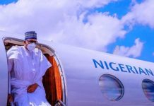 President Muhammadu Buhari wearing face mask in public for the first time
