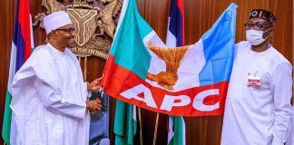 President Muhammadu Buhari presenting the APC party flag to Pastor Osagie Ize-Iyamu pdp