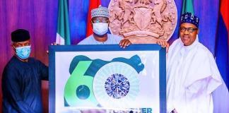 Vice President Yemi Osinbajo, SGF Boss Mustapha and President Muhammadu Buhari unveiling the Nigeria At 60 logo