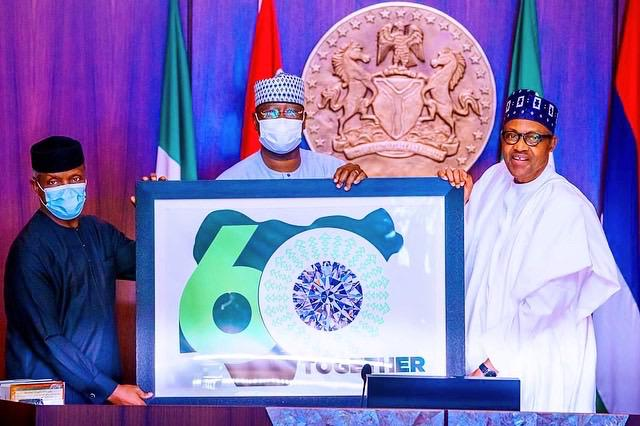 Vice President Yemi Osinbajo, SGF Boss Mustapha and President Muhammadu Buhari unveiling the Nigeria At 60 independence logo