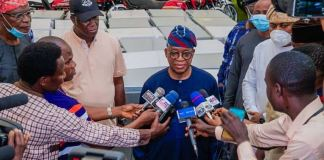 Governor Gboyega Oyetola supervising the items returned by looters in Osun State