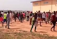 Residents looting a warehouse in Plateau state adamawa