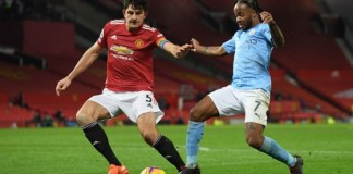 Harry Maguire stops Raheem Sterling as Manchester United played a drab draw with Manchester City