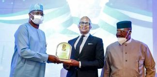L-R: Secretary to the Government of the Federation, Boss Mustapha; Group Managing Director/CEO, Kennedy Uzoka; Member of Board of Trustees, Public Policy Research and Analysis Centre (PPRAC), organiser of Zik Prize, Marc Wabara, during the conferment of Zik Prize for Professional Leadership on Uzoka in Lagos on Sunday