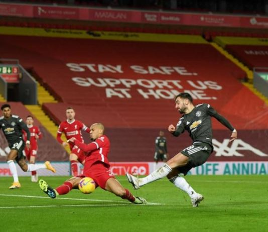 Liverpool defender Fabinho blocked a Bruno Fernandes strike following a rare Manchester United attack