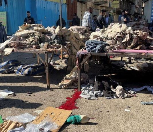 The attack targeted people shopping at a clothing market in Tayaran Square in Baghdad