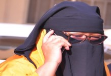 Aisha Alkali Wakil aka Mama Boko Haram claims not to be able to speak but is seen recieving a phone call