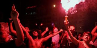 Protesters erupted with celebrations at the news that the prime minister had been dismissed