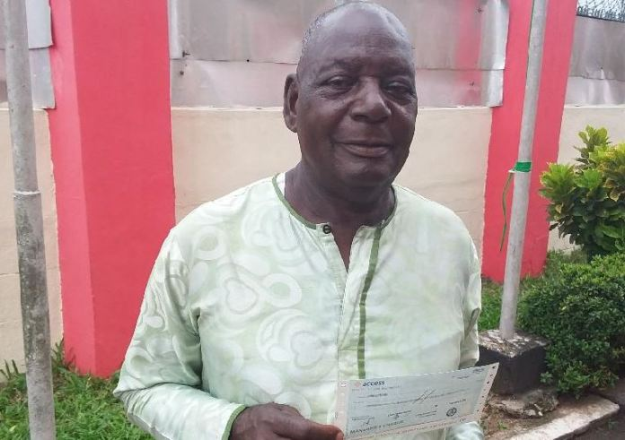 An elated John Ederaro, 81, holds the cheque received from EFCC
