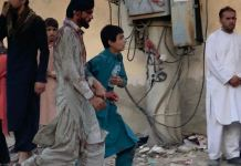 A man walking away bloodied after the explosion at the Baron Gate in Kabul, Afghanistan IS-K