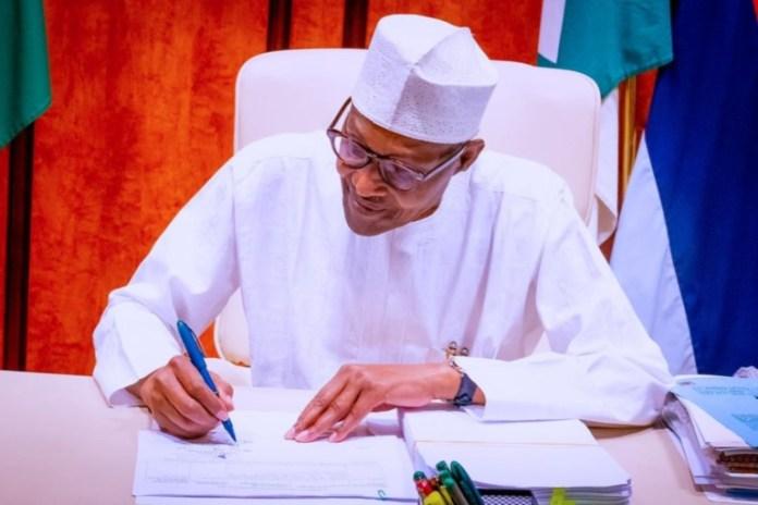President Muhammadu Buhari signs PIB into law PIA