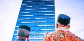 Vice President Yemi Osinbajo and Governor Udom Emmanuel looking at the imposing 21-storey Dakkada Tower