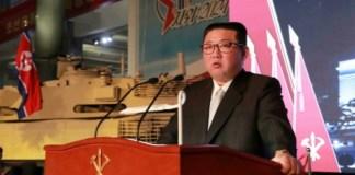 North Korean Supreme Leader Kim Jong Un stands beside a nuclear missile