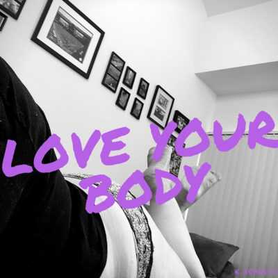 "a photo of me laying down on my stomach; you only see me from the waist down, with sexy lacy underoos on my bum; the picture is B&W with purple text overlay that says ""love your body"""
