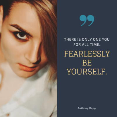 "on left, photo of a white appearing person with an angular haircut, heavy eye makeup, and wearing a white top; on right, a blue box with light blue quotation mark, white text ""There is only one you for all time"" - yellow text ""fearlessly be yourself"" and at bottom middle white text ""Anthony Rapp"""