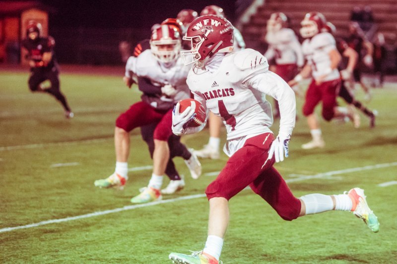 W.F. West's Cade Haller (4) runs with the football during the Swamp Cup game against Centralia Saturday night at Tiger Stadium.