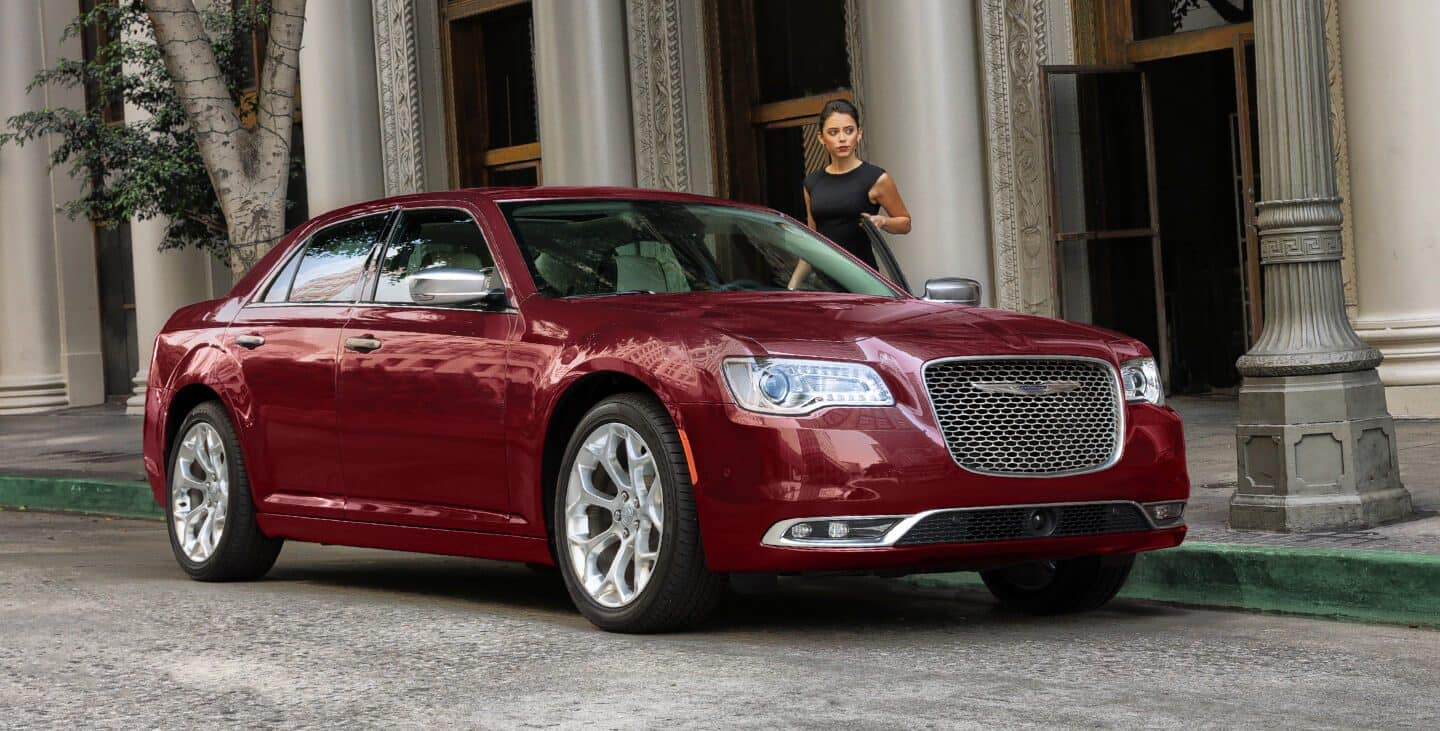 hight resolution of display a woman entering a 2019 chrysler 300c with polished aluminum wheels and a platinum grille