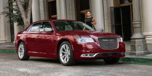 small resolution of display a woman entering a 2019 chrysler 300c with polished aluminum wheels and a platinum grille