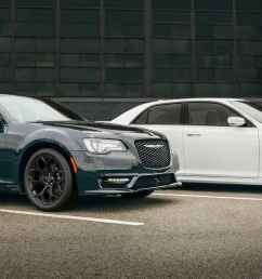 display two 2019 chrysler 300s models parked side by side near a warehouse  [ 1440 x 731 Pixel ]