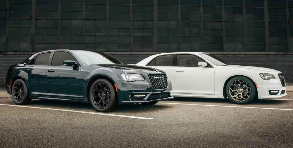 medium resolution of display two 2019 chrysler 300s models parked side by side near a warehouse