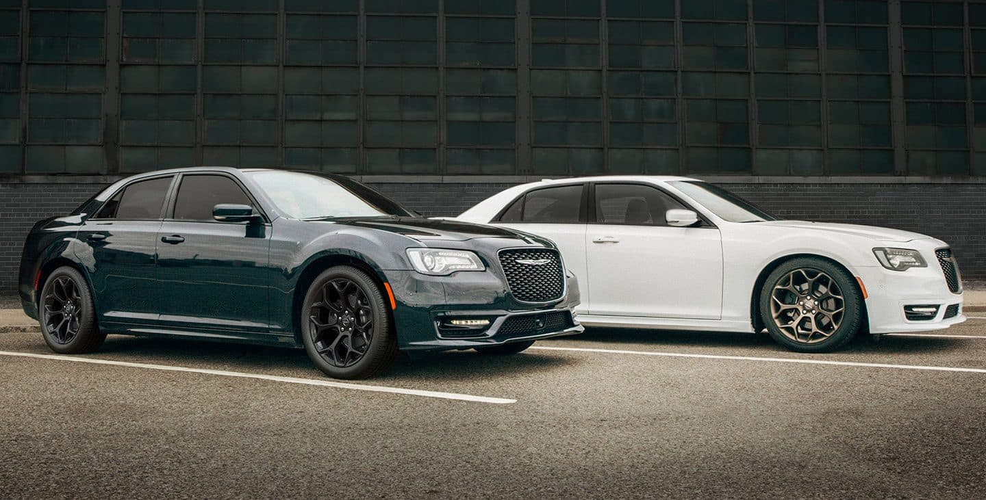 hight resolution of display two 2019 chrysler 300s models parked side by side near a warehouse