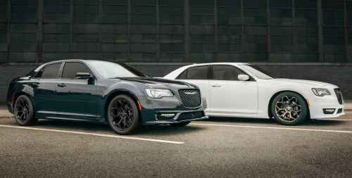 small resolution of display two 2019 chrysler 300s models parked side by side near a warehouse