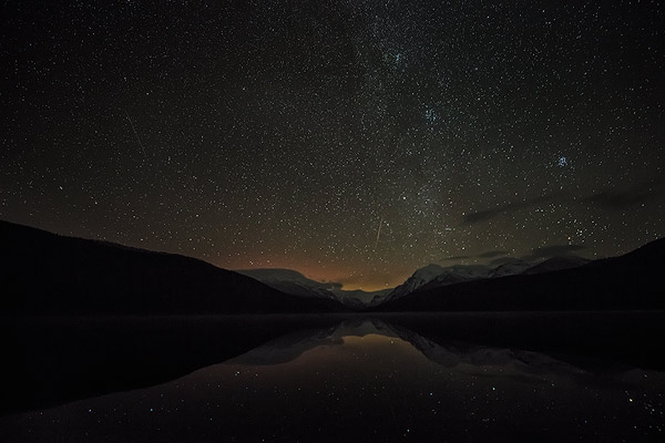 Starry skies over Bowman Lake in Glacier National Park, Montana
