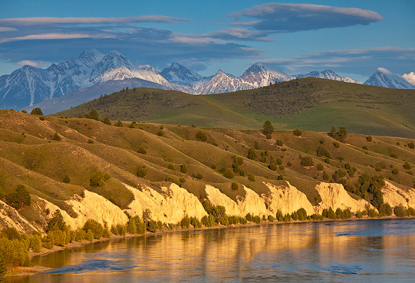 Mission Mountains loom over the Flathead River in Mission Valley, Montana, USA