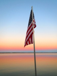 flag over the Seneca lake shoreline