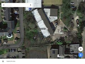 Google Maps captures the first stage of demolition.
