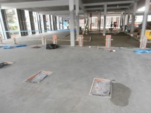On the north side, the floor of the Fitness Suite is now set.