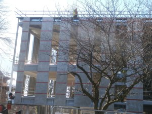 That safety fencing again and workers on the roof of the new-build too.