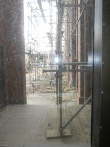 The quadrangle at the back is also now a maze of inter-linked metal scaffolding poles.