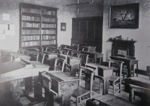 A typical classroom at Newcastle High School complete with its Arts & Crafts fire place.