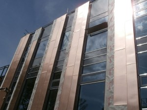 The south face of the new-build now shining bright in the sunshine.