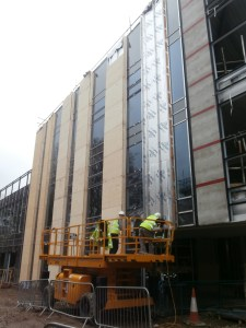 Insulation being applied to the south façade.