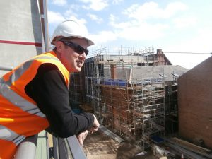 Peter Wilson enjoys the view from the roof-top terrace this sunny afternoon.
